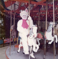 Easter Bunny on the Merry-Go-Round at Frontier Village.