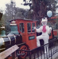 Easter Bunny standing in engine car of Frontier Village Railroad.